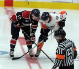 Connor Brown of the Saginaw Spirit lines up for a faceoff across from Connor Chatham of the Flint Firebirds.