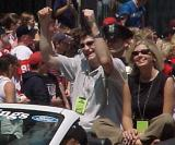 Boyd Devereaux pumps his fists in celebration during the parade honoring the Red Wings' 2002 Stanley Cup Championship.