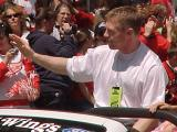 Kris Draper waves to fans during the parade honoring the Red Wings' 2002 Stanley Cup Championship.