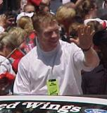 Kris Draper smiles and waves to fans during the parade honoring the Red Wings' 2002 Stanley Cup Championship.