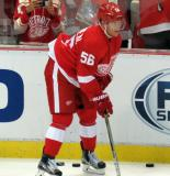 Teemu Pulkkinen skates near the boards during pre-game warmups.