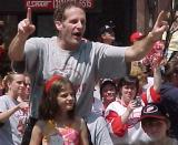 Steve Duchesne pumps his fists in celebration during the parade honoring the Red Wings' 2002 Stanley Cup Championship.