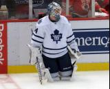 James Reimer of the Toronto Maple Leafs kneels near the boards during pre-game warmups before a game against the Detroit Red Wings.