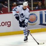 Shawn Matthias of the Toronto Maple Leafs skates along the boards during pre-game warmups before a game against the Detroit Red Wings.