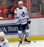Brad Boyes of the Toronto Maple Leafs stands at the boards during pre-game warmups before a game against the Detroit Red Wings.