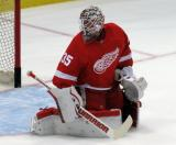 Jimmy Howard looks over his shoulder after dropping to make a save during pre-game warmups.