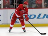 Brendan Smith passes the puck from near the boards during pre-game warmups.