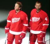 Justin Abdelkader and Jakub Kindl stand at the blue line during player introductions at the Red Wings' home opener.