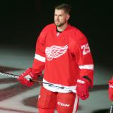 Mike Green stands at the blue line during player introductions at the Red Wings' home opener.