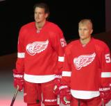 Danny DeKeyser and Teemu Pulkkinen stand at the blue line during player introductions at the Red Wings' home opener.