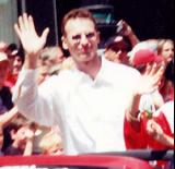 Dominik Hasek waves to fans at the 2002 Stanley Cup Championship parade.