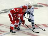 Dylan Larkin lines up for a faceoff opposite Martin Marincin of the Toronto Maple Leafs.
