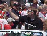 Tomas Holmstrom reaches out toward fans during the parade honoring the Red Wings' 2002 Stanley Cup Championship.