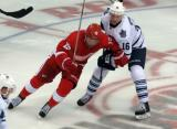 Riley Sheahan fights for space with Nick Spaling of the Toronto Maple Leafs.