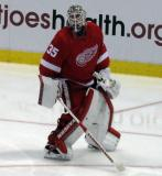 Jimmy Howard comes out of his crease to play the puck.
