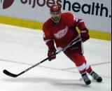 Mike Green skates in the defensive zone.