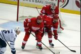 Jimmy Howard, Jakub Kindl, Drew Miller, and Toronto's P.A. Parenteau get set for a faceoff.