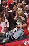 Former Red Wing Joey Kocur waves at fans during the parade honoring the Red Wings' 2002 Stanley Cup Championship.
