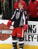 Nathan Paetsch stands near the bench during pre-game warmups before a Grand Rapids Griffins game.