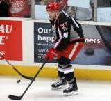 Brian Lashoff skates near the boards during pre-game warmups before a Grand Rapids Griffins game.