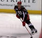 Louis-Marc Aubry skates with the puck during pre-game warmups before a Grand Rapids Griffins game.