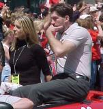 Maxim Kuznetsov whistles at fans during the parade honoring the Red Wings' 2002 Stanley Cup Championship.