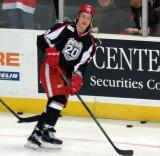Todd Bertuzzi skates with the puck during pre-game warmups before a Grand Rapids Griffins game.