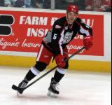 Robbie Russo skates near the boards during pre-game warmups before a Grand Rapids Griffins game.