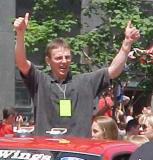 "Igor Larionov gives the ""thumbs up"" sign to fans during the parade honoring the Red Wings' 2002 Stanley Cup Championship."