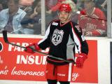 Robbie Russo stands at the boards during pre-game warmups before a Grand Rapids Griffins game.