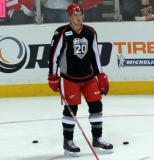 Anthony Mantha stands in the left faceoff circle during pre-game warmups before a Grand Rapids Griffins game.