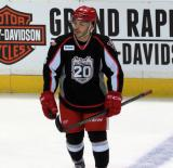 Robbie Russo skates along the blue line during pre-game warmups before a Grand Rapids Griffins game.