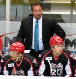Todd Nelson, Grand Rapids Griffins head coach, stands on the bench behind Andreas Athanasiou and Anthony Mantha during a stop in play.