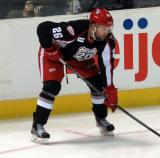 Eric Tangradi lines up at wing for a faceoff during a Grand Rapids Griffins game.