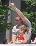 Darren McCarty raises a fist in celebration during the parade honoring the Red Wings' 2002 Stanley Cup Championship.