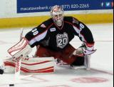 Tom McCollum stretches on the ice during a stop in play in a Grand Rapids Griffins game.