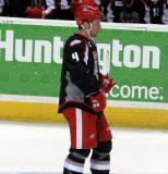 Nathan Paetsch skates near the bench during a stop in play in a Grand Rapids Griffins game.
