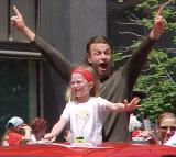 Fredrik Olausson lifts his arms in celebration during the parade honoring the Red Wings' 2002 Stanley Cup Championship.