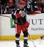Jeff Hoggan stands in front of the bench during a stop in play in a Grand Rapids Griffins game.