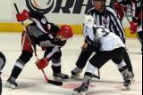 Tomas Nosek gets set for a faceoff against Colin Smith of the San Antonio Rampage during a Grand Rapids Griffins game.