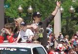 Luc Robitaille waves to the fans while holding the Clarence Campbell Bowl during the parade honoring the Red Wings' 2002 Stanley Cup Championship.