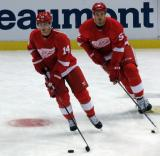 Gustav Nyquist and Jonathan Ericsson turn in the neutral zone during pre-game warmups.