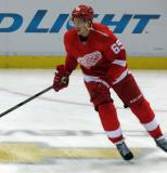 Danny DeKeyser skates in the neutral zone during pre-game warmups.