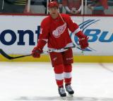 Luke Glendening stands in the neutral zone during pre-game warmups.