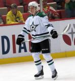 Mattias Janmark of the Dallas Stars skates near the boards during pre-game warmups before a game against the Detroit Red Wings.