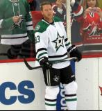 Ales Hemsky of the Dallas Stars stands at the boards during pre-game warmups before a game against the Detroit Red Wings.