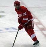 Drew Miller skates at center ice during pre-game warmups.