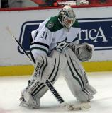 Antti Niemi of the Dallas Stars warms up near the boards during pre-game warmups before a game against the Detroit Red Wings.