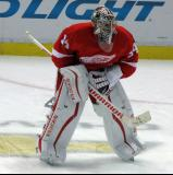 Petr Mrazek crouches in the neutral zone during pre-game warmups.