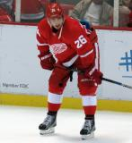 Tomas Jurco crouches near the boards during pre-game warmups.